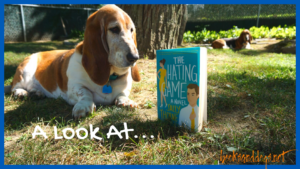 The Book the Hating Game, a workplace romance, with 2 Basset Hounds